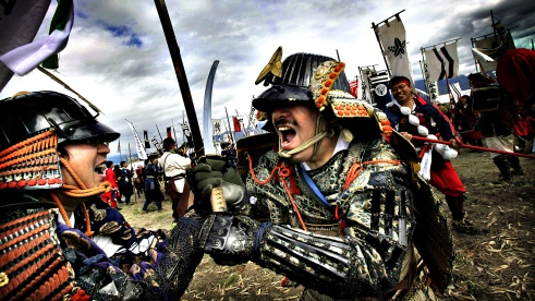 In this Sunday, April 21, 2013 photo, men dressed as samurai warriors fight with swords during a re-enactment of the Battle of Kawanakajima, which was fought in the mid 16th century, in Fuefuki, Yamanashi Prefecture, northeast of Tokyo. Every April participants hold a re-enactment to mark the harshest of a series of five battles between two famous warlords, Kenshin Uesugi and Shingen Takeda. The event reflects growing interest among Japanese in feudal-era leaders. (AP Photo/Junji Kurokawa)