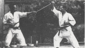 Kobudo training, Okinawa, note the hojo undo tools in the ba