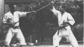 Kobudo training, Okinawa, note the hojo undo tools in the ba