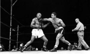 Rocky-Marciano-punch-Jersey-Joe-Walcott--300x179